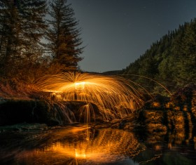 Bright water fountain in natural landscape Stock Photo