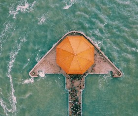 Canoe cruising on jetty area from altitude Stock Photo