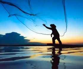 Cast net fishing Stock Photo