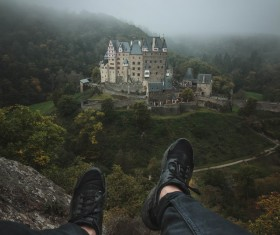 Closeup of man legs and castle landscape Stock Photo
