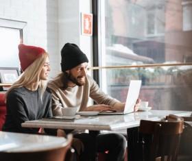 Couple drinking coffee browsing webpage Stock Photo 11