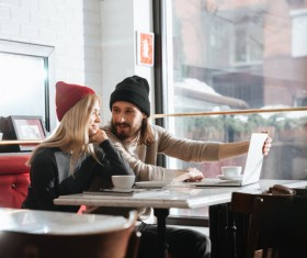 Couple drinking coffee browsing webpage Stock Photo 12
