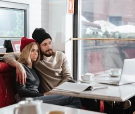 Couple drinking coffee browsing webpage Stock Photo 13