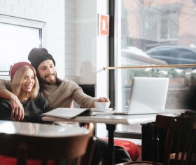 Couple drinking coffee browsing webpage Stock Photo 14