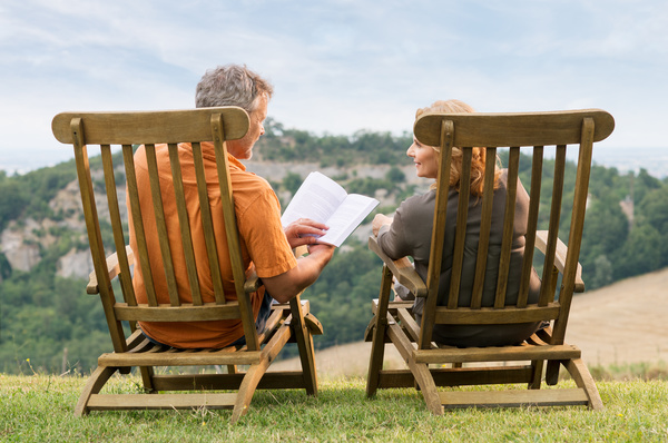 Couple relaxing reading book Stock Photo