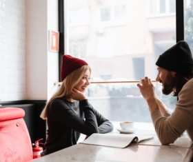 Couple sitting in cafe watching smartphone taking photo Stock Photo 02