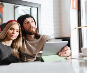 Couple using Tablet PC Listen to music Stock Photo 02