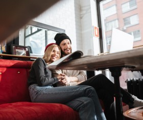 Couple using laptop video chat in cafe Stock Photo 02
