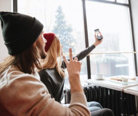 Couple using smartphone selfie in cafe Stock Photo 04