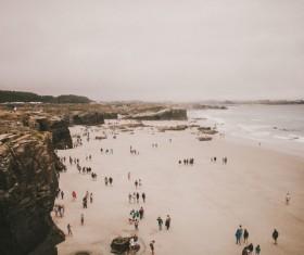 Crowded beach scenery in wintertime Stock Photo