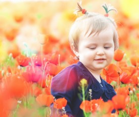 Cute girl among flowers Stock Photo