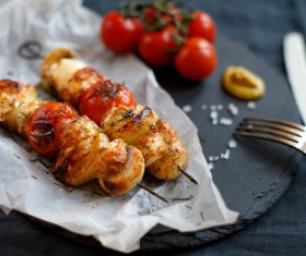 Delicious kebab and tomatoes Stock Photo
