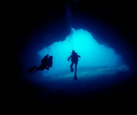 Diver inspect underwater cave Stock Photo 01