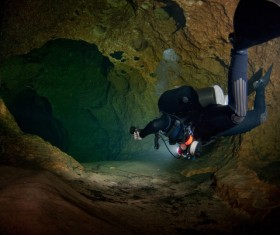 Diver inspect underwater cave Stock Photo 02