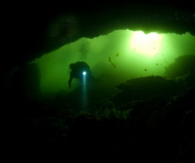 Diver inspect underwater cave Stock Photo 03