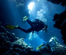 Diver inspect underwater cave Stock Photo 04