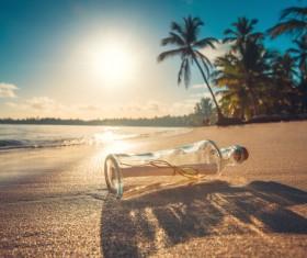 Drifting bottle on the beach Stock Photo