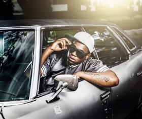 Fashionable black guy sitting in car Stock Photo