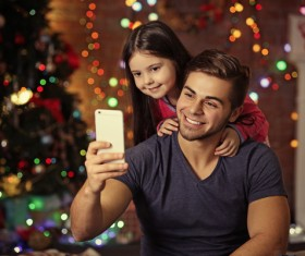 Father daughter using smartphone selfie Stock Photo