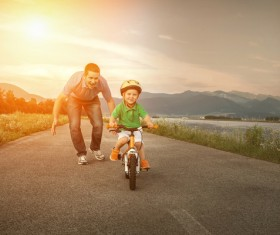 Father watching his son cyclist Stock Photo