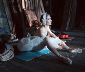 Female ballet dancer resting in the background Stock Photo