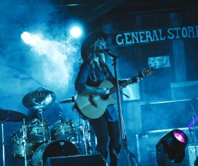 Female singer performing on smoke stage Stock Photo