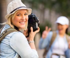 Female tourist using camera to take photos Stock Photo