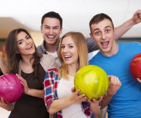 Friends bowling together Stock Photo 01