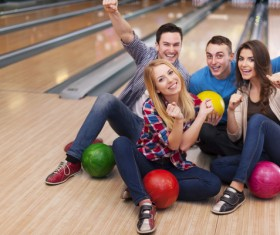 Friends bowling together Stock Photo 02