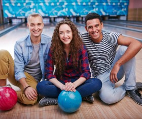 Friends bowling together Stock Photo 03