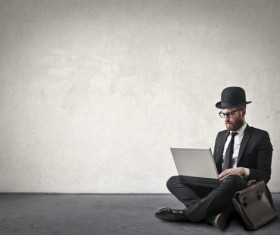 Gentleman using laptop Stock Photo