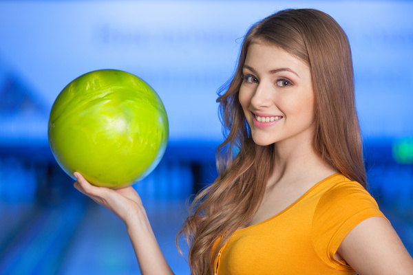 Girl holding a bowling ball Stock Photo