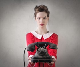 Girl holding old-fashioned phone Stock Photo