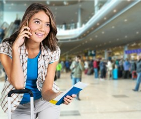 Girl is phoning in airport waiting room Stock Photo