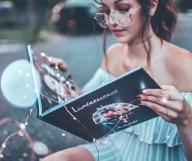Girl reading magazine Stock Photo