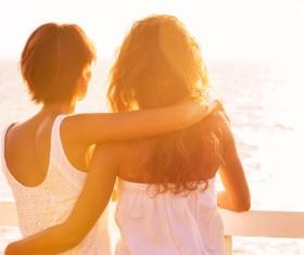 Girlfriend watching sunrise Stock Photo