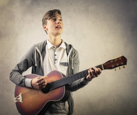 Handsome boy plays guitar Stock Photo