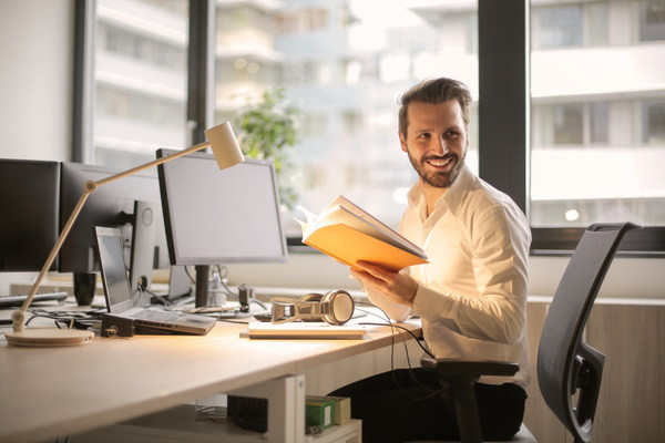 Handsome man in office Stock Photo