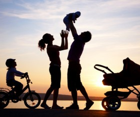 Happy family in the sunset Stock Photo
