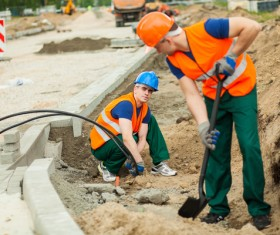 Hard work road construction workers Stock Photo 15