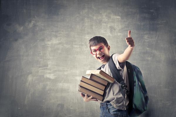 Holding books little boy Stock Photo