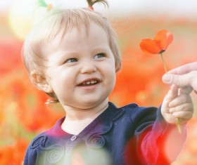 Holding red flowers cute little girl Stock Photo