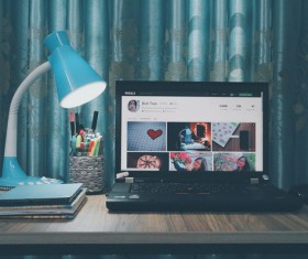 Home computer desk items placed Stock Photo