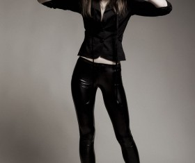 Leather pants girl wearing mask Stock Photo