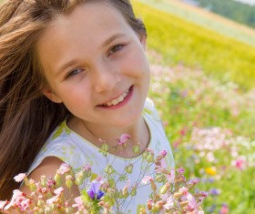 Little girl standing on wildflower meadow Stock Photo 01