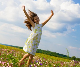 Little girl standing on wildflower meadow Stock Photo 02