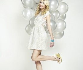 Lively cute girl holding balloons Stock Photo 0