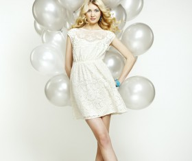 Lively cute girl holding balloons Stock Photo 02