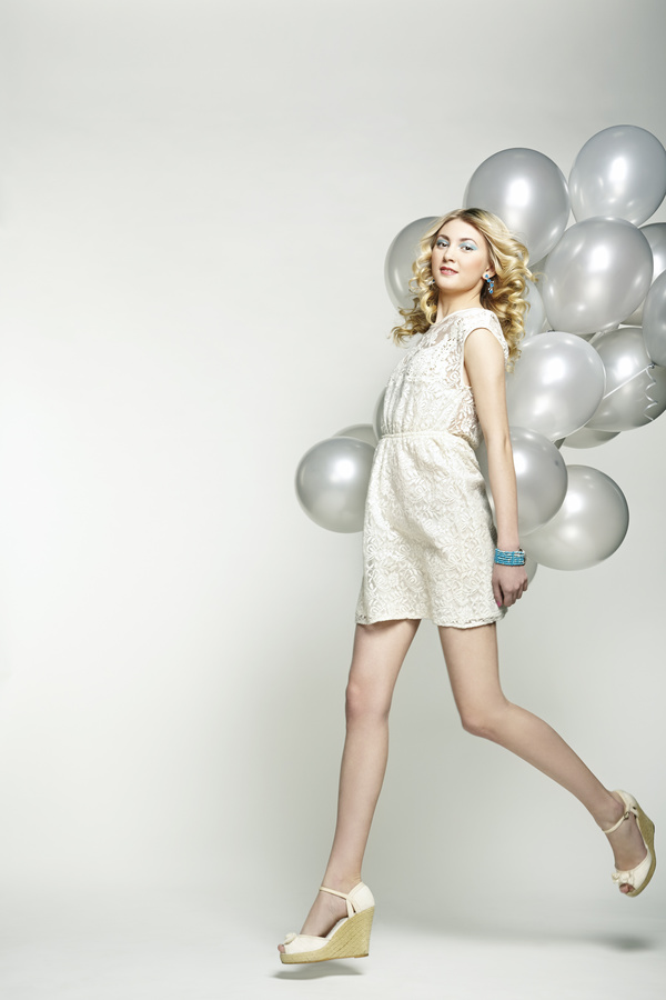 Lively cute girl holding balloons Stock Photo 03