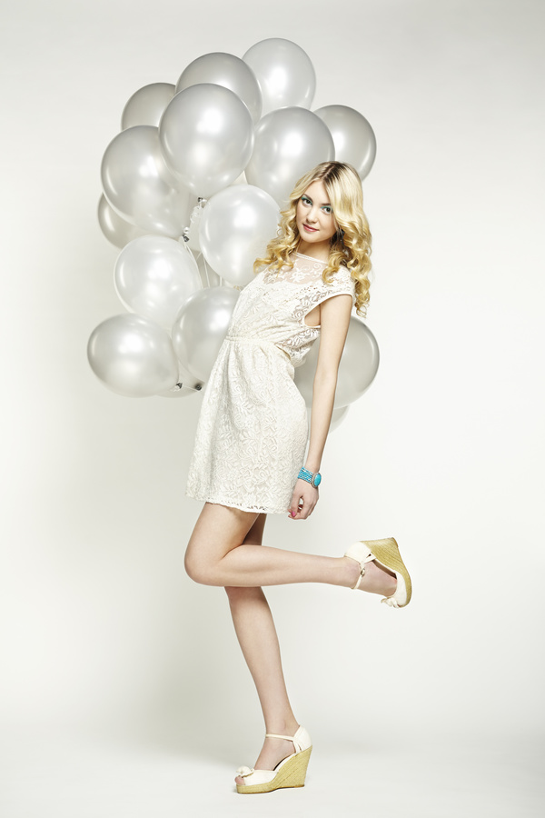 Lively cute girl holding balloons Stock Photo 04